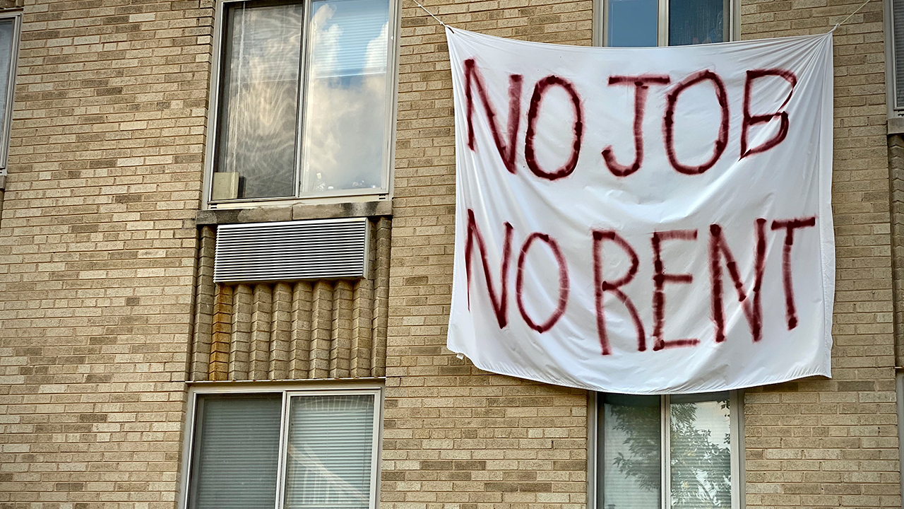 A banner against renters eviction reading no job, no rent is displayed on a controlled rent building in Washington, DC. (Eric Baradat/Getty Images)